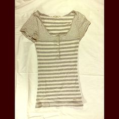 Grey & White Striped Short Sleeved Shirt Very cute light grey and white striped shirt from Aeropostale! It's a stretch fit so it fits pretty well to your figure. Aeropostale Tops Tees - Short Sleeve