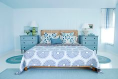 Blue, Blue, Blue Bedroom with dressers as nightstands - designed by Alexandra Angle and photographed by Victoria Pearson in House Beautiful