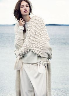 Chunky ball-knit wrap layered over a loose sweater and baggy trousers // via Elle