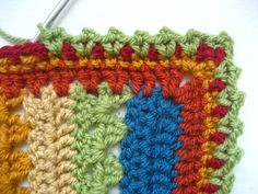 Crochet a blanket (this one is the Cozy Stripe blanket) and make the border 3 rows of dc and one of picot. There are questions in the comments that the designer does not answer, but crocheters do.