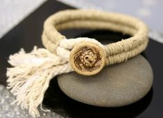 Chunky woven bangle bracelet with fringe and ceramic button