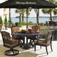 Perfect for  warm weather and good food. Woven cast metal round dining table and swivel rocker dining chairs.