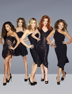 """After eight years of sassy attitude, """"Desperate Housewives"""" wrapped up Sunday night with more warm hugs than a Barney therapy session.  http://refer.ly/a0zs"""