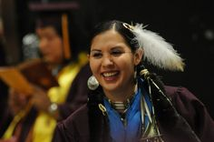 A graduate celebrates during an American Indian convocation at ASU.