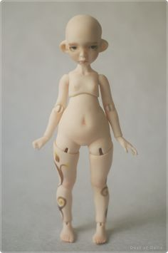 Puns by Dust of Dolls.  Same bald head and pear shaped body, love it !    kc