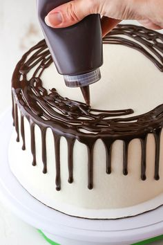 Learn to make a Chocolate Drip Cake with this easy method! All you need is chocolate ganache a frosted cake and a few simple tools. Youll be on your way to an impressive yet easily decorated cake in no time! Red Wine Chocolate Cake, Chocolate Cake Designs, Semi Sweet Chocolate Chips, Chocolate Decorations For Cake, Chocolate Cake Decorated, Chocolate Drip Cake Birthday, Easy Chocolate Ganache, Chocolate Fondue, Bolo Drip Cake