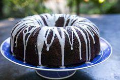 Tried and true moist chocolate zucchini cake with shredded zucchini, orange peel, pecans and a sugar glaze.