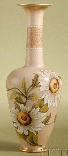 A Doulton Lambeth Salt-Glaze Carrara Ware Bottle-Form Vase, with hand painted production marks, with slender gilded neck and  flared lip decorated with a band of foliage, the body painted with stylized sunflowers or white dahlias, circular gilded foot, England, circa 1890-1900