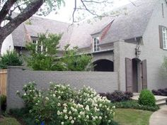 brick + shutter doors + hydrangeas + grey thayermanor.wordpress.com