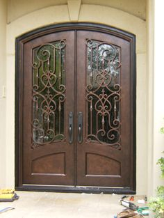 Custom wrought iron double entry door. Doors by Design.