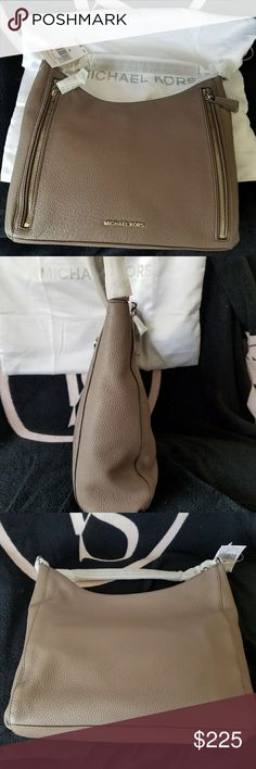 """NWT Michael Kors Shoulder bag NWT Michael Kors Shoulder bag. Has 2 zippered pockets on the front. Silver hardware. Top Zipper closure.  Interior has zippered pocket plus 4 other slip pockets inside. Dust bag included. Length: 12.5, height: 10"""", width: 4"""". ** Sorry, no trades. Please do not post offers in comments **  FIRST REASONABLE OFFER TAKES IT ** MICHAEL Michael Kors Bags Shoulder Bags"""