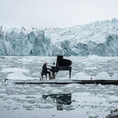 Italian composer and pianist Ludovico Einaudi performs a specially composed 'Elegy for the Arctic' on a floating platform in the Arctic Ocean, in front of the Wahlenbergbreen glacier in the Svalbard archipelago, near Ny-Alesund, Norway on June 16th 2016. Greenpeace is urging the OSPAR Commission, which meets between June 20th and 24th 2016, to protect the international Arctic waters under its mandate. Credit: AFP/Greenpeace/Pedro Armestre #Arctic #ElegyfortheArctic #glacier #LudovicoEinaudi