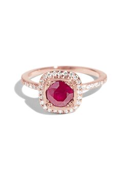 This personalized Quince Ring features a ruby as the center stone surrounded by a halo of 1mm white diamonds.