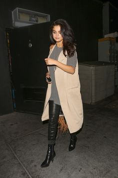 """June 25: Selena leaving """"The Nice Guy"""" after attending Tori Kelly's album release party in West Hollywood, California"""