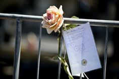 A flower and thank-you letter left for Nelson Mandela in Cape Town, South Africa, on Friday.
