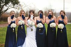 Winter wedding gloves..white and blue bouquets with hydrangea, tulips and roses..navy bridesmaids