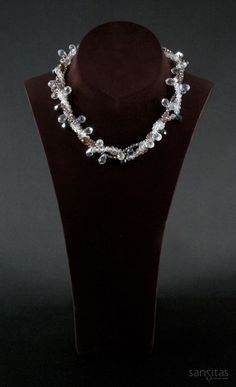 Upendo White and Purple - A multi-stranded charmer comprised of both briolette and teardrop shaped crystals. Versatile enough to transform day to evening wear, its sure to be a complement to any wardrobe!