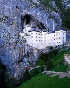 Predjama Castle in Slovenia is one of the most fas. Predjama Castle in Slovenia is one of the most fascinating structures in all of Europe. Built right into a complex cave system Places Around The World, Oh The Places You'll Go, Places To Travel, Places To Visit, Around The Worlds, Beautiful Castles, Beautiful Places, Architecture Unique, Fairytale Castle