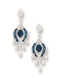PAIR OF ALEXANDRITE AND DIAMOND EARRINGS. Each centring on an oval alexandrite weighing 2.29 and 2.17 carats, to an openwork background set with eight oval alexandrites, supporting a cascading fringe of marquise-shaped diamonds, decorated with marquise-shaped and circular-cut diamonds, the alexandrites and diamonds altogether weighing approximately 3.55 and 5.15 carats respectively, mounted in 18 karat white gold.
