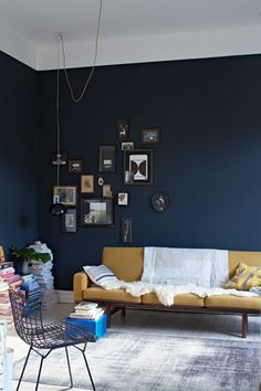 Dark blue wall living room, Yellow sofa | Janne Peters