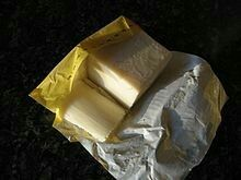 Palm oil block showing the lighter color that results from boiling.