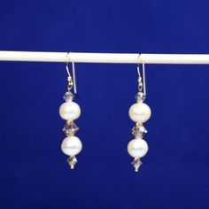 """""""Cream Dream Pearl Earrings"""". Gorgeous Cultured Pearl Earrings in Cream shade pair with Swarovski Crystals in Champagne. Crystals are 6-4mm Bicones  adding sparkle to compliment the Pearls. 1 1/4"""" length. Gold Filled Bali Hook Ear Wires with Ball Ends. Leverbacks upon request. See marching Necklace under Jewelry Sets. The 7-8mm Pearls can have some variation in size & finish. Wonderful for a Wedding!! Only at: http://americanjewelryvision.com/products/copy-of-cream-dream-pearl-necklace-set"""