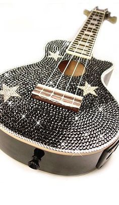 Bedazzled star guitar @Austin Fullmer ohmygod yes!!!!!!!!!!!!! forget that butterfly I want this!!!!!! Please please please pleeeeeeeeease!