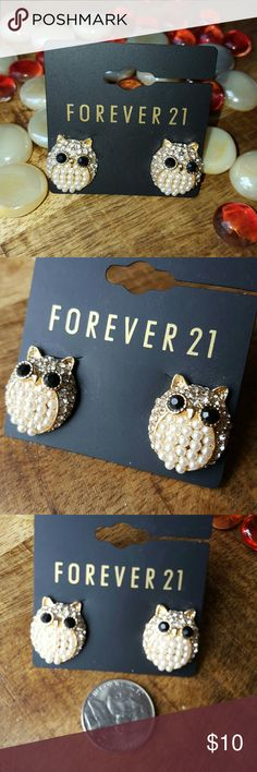 Cute owl earrings! Cute owl earrings with faux diamonds head and wing and pearl belly. They have a flower shaped cluster on their foreheads. Black, faceted glass eyes and post backs. New and unworn. Would make a nice gift! FREE with any $50 purchase. Just mention in comments. Forever 21 Jewelry Earrings