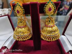 Stunning gold Jumkhi with parrot design. jjumkhi studded with multi precious stones. Earrings with gold ball hangings. Silver Ring Designs, Gold Earrings Designs, Gold Jewellery Design, Necklace Designs, Diamond Earrings Indian, Gold Jhumka Earrings, Gold Rings Jewelry, Ruby Jewelry, Gold Buttalu