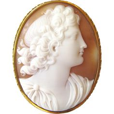 Neo-Classical Shell Cameo Brooch by gandsco on Ruby Lane. Victorian era classical revival carved shell cameo brooch in a 14 karat yellow gold frame. Circa 1860, Italy.