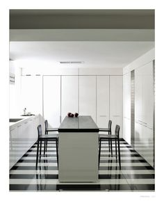 Kitchen Dreams. glossy black and white kitchen floors. Designers: Daniel Cuevas + Carole Katleman.