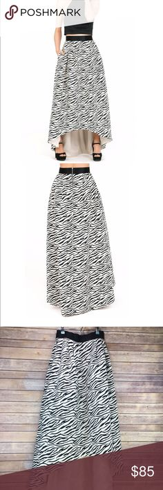 """High-low Zebra Print Skirt Amazing!!! New without tags- I bought this over the summer at a boutique near me, but never wore it.   It is an off-white white, heavy quality fabric. Beautiful structure! Not too heavy that you should be uncomfortable. Not a cheap material. Has two pockets!  Cannot be bundled due to weight!  Size 8, RUNS SMALL IN WAIST! I am 5'6"""" 135lbs, and this is the perfect size for me.  Please see measurement photo to ensure fit prior to purchase. All measurements are…"""