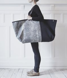 Luxe version of the Ikea bag everyones hates to love. ;) Herman Cph makes a version in Kvadrat fabrics.