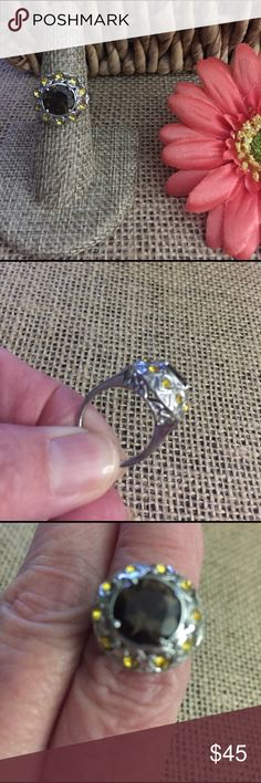 Smokey Quartz & Sunflower Swarovski Ring sz 6 People will grab your hand!  This is beautiful and I want it for my collection but I bought it for you guys so here it is!  Center stone is 3 cts of Smokey Quartz, 1/2 ct of Sunflower Swarovski crystal all set in stainless steel. Sz 6, new with tags. Offers and bundles welcome. R297 Jewelry Rings