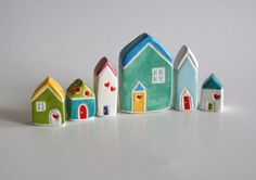 I collect little ceramic houses from Greece, Jamaica, and the USA