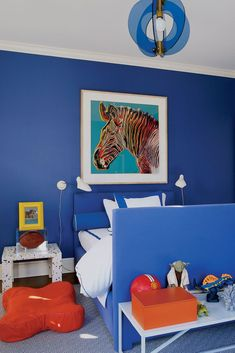 Style-setter Aerin Lauder decorated her son's East Hampton bedroom in electric shades of blue.