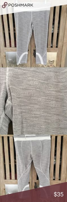 Lululemon Pants Gray and white stripe lulu pants! Small hole in back- see photo-  cheap price due to this! Easy to repair lululemon athletica Pants