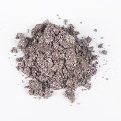 Antique Silver Mica- A warm, beautifully tarnished silver. Barely there hints of pale green shimmers amidst a mauve-taupe base. This mica is both lip and eye safe and works great in cold process.