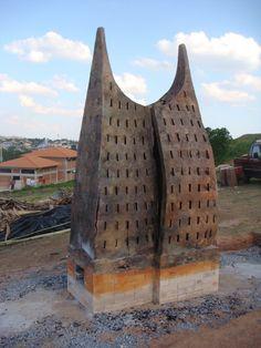 Monumental fire sculpture in São João Del Rey, Brazil by ceramic artist Nina Hole.