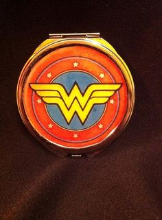 Wonder Woman compact mirror by Airship67 $15 https://www.etsy.com/listing/216392610/dc-girls-compact-mirror-your-choice-of?ref=shop_home_active_18