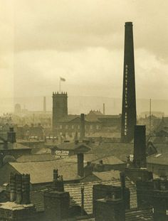 Black and white photograph taken from roof of Whiteheads department store in 1939. View of rooftops and Bark St Mills chimney, Bolton.