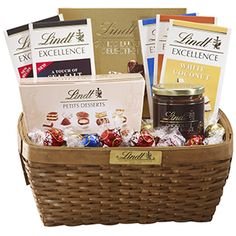 An excellent way to give chocolate gifts that offer a taste of our different chocolate collections. Includes five Lindt EXCELLENCE Bars in Extra Creamy Milk Chocolate, 70% Cocoa, A Touch of Sea Salt, Toffee Crunch and White Coconut; one each Petits Desserts Ballotin Box and Swiss Luxury Selection Box; one jar Lindt Chocolate Fudge Sauce (9.5oz); and 45 assorted smooth melting LINDOR truffles in milk, dark, white, hazelnut and peanut butter.  $90 - Search for Product # 7864