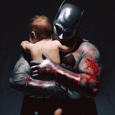 Batman holding a baby