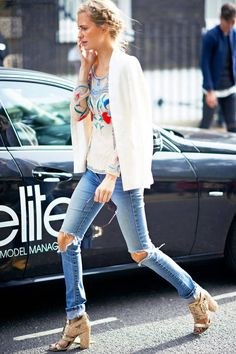 A white blazer and heels dresses up a pair of distressed jeans. | 32 Perfect Fall Outfits