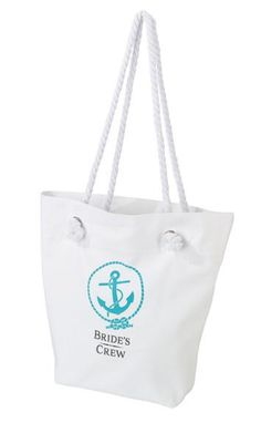 "This ""Bride's Crew"" white canvas beach bag is an ideal bridesmaid gift for wedding day essentials, a picnic or day at the beach. Bag measures 16.25"" x 13""."