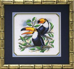 "COUNTED CROSS STITCH KIT TOUCANS PRODUCT DETAILS: Article: PT-0779 The size of the finished work: 22 x 22 cm Technique: Counted cross Circuit Type: Black and white Type of canvas / fabric: K04 Aida №14 ""Gamma"" Color canvas / fabric: white Additional Items: None Filling: Partial Number of colors: 19 The number of mixed colors (Bland): 3 The frame in kit is not included. Manufacturer: Panna (Russia)"