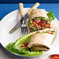 "Mediterranean Salmon Wrap: This Mediterranean-inspired sandwich starts with convenient canned salmon. ""Wrapped up with silky-sweet roasted red peppers in a lemon-olive oil dressing"