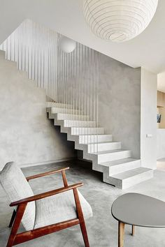 Contemporary minimalistic interior with concrete floor and staircase. Pepe Gascón Arquitectura