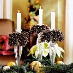 Make your space shine by creating beautiful homemade candlestick holders. Here, the elegant creations were placed on a tabletop and surrounded by fresh evergreen sprigs and sparkling gold ornaments. See the next slide for instruction to make the pinecone candlesticks./