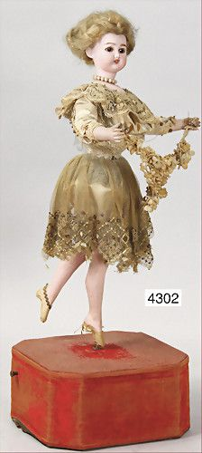 machine, ballet dancer, biscuit porcelain socket head, on a biscuit porcelain breast plate, marked S & H Germany number 2, blue fix inset glass eyes, real hair, opened mouth, upper teeth, bisque arms, old clothes, blond fix glued on mohair wig, tear at the side, 1 firing crack behind the ear, with music mechanism, intact, height of the doll c. 41 cm, total height 50 cm, fine lace dress, fabric floral decorations, very decorative
